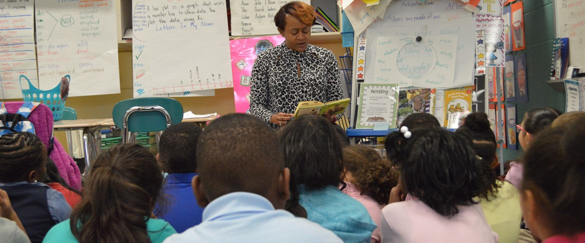 Mrs. Harvey Reading to students