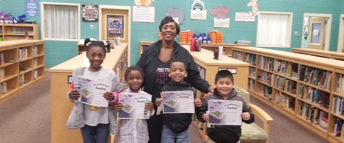 Ms. Glover and students with the highest STAR Reading growth