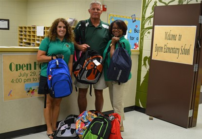 BES Staff with donated bookbags