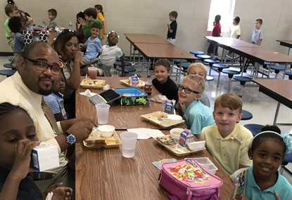 BES admin eating lunch with students