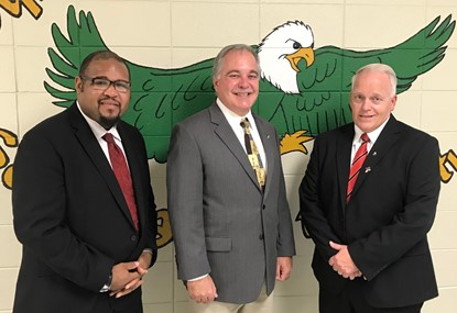 Assistant Principal Brandon Hall, GA School Superintendent Richard Woods, and Principal Keith Lauritsen